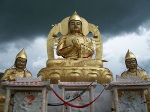 Gold statues on a rainy day.