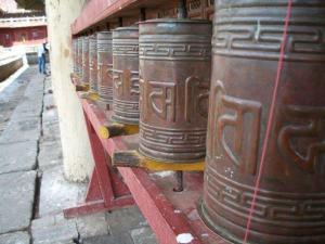 Prayer wheels outside a temple.
