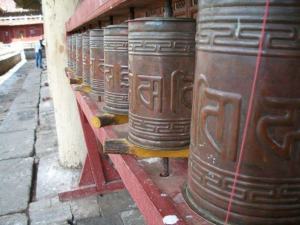 Prayer wheels outside a temple.